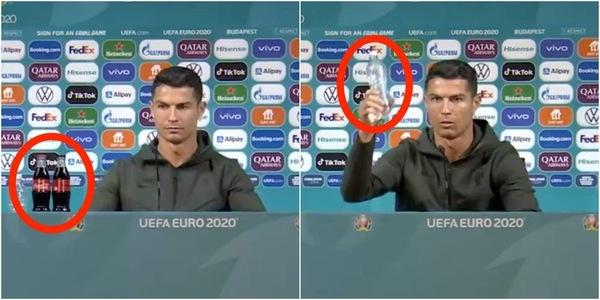 Cristiano Ronaldo holding a Coke bottle